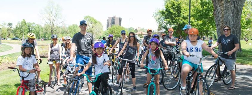 group of people riding bikes