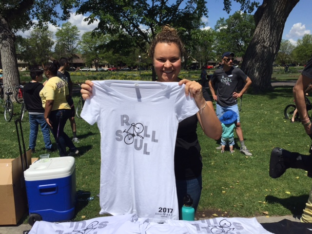 girl holding roll with soul white t-shirt
