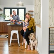 family of four in kitchen with dog