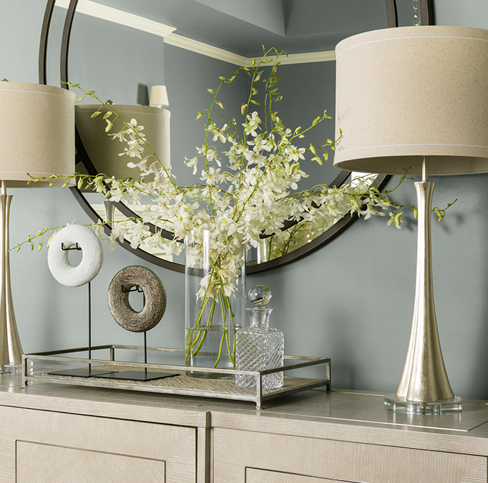 Table with flowers and lamps
