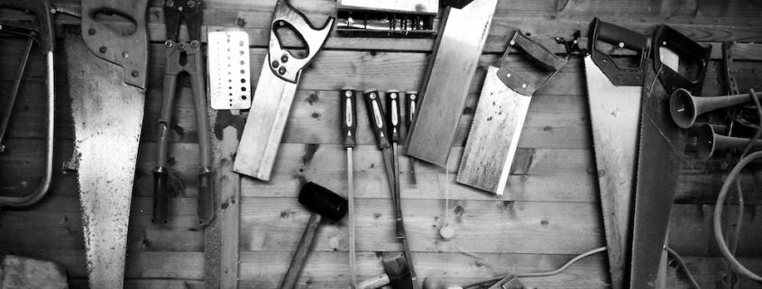 tools hanging on a wooden wall
