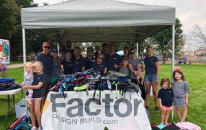 The Factor Team with School Supplies at Denver Kids Backpack to School   Factor Design Build Blog   Denver CO