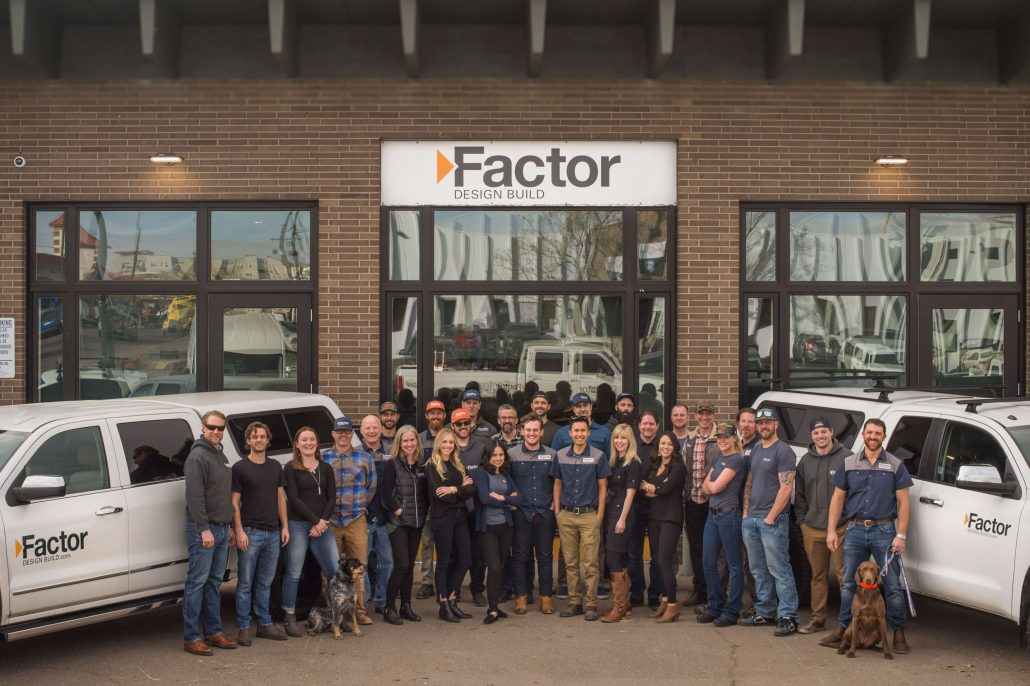 Factor Design Build team photo in front of headquarters