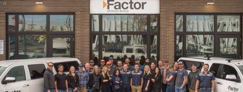 Factor Design Build team photo in front of headquarters