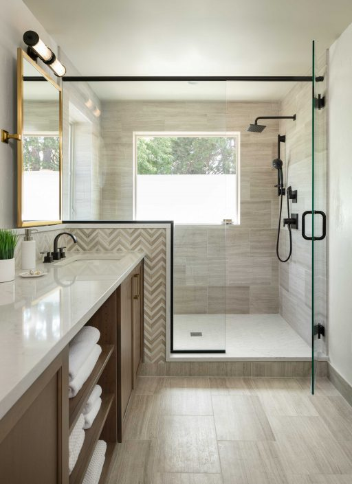 remodeled bathroom with view of vanity and shower