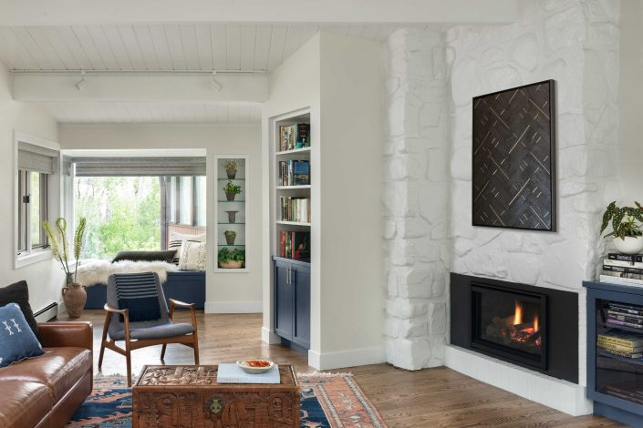 Cozy remodeled living room with fireplace and window reading nook