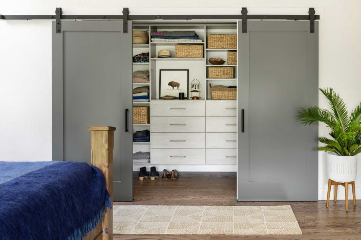 Barn doors open on custom closet