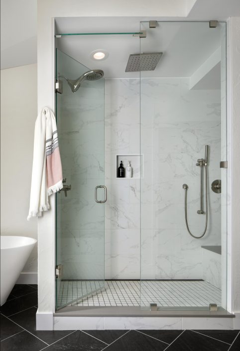 Glass shower with a rainfall shower head