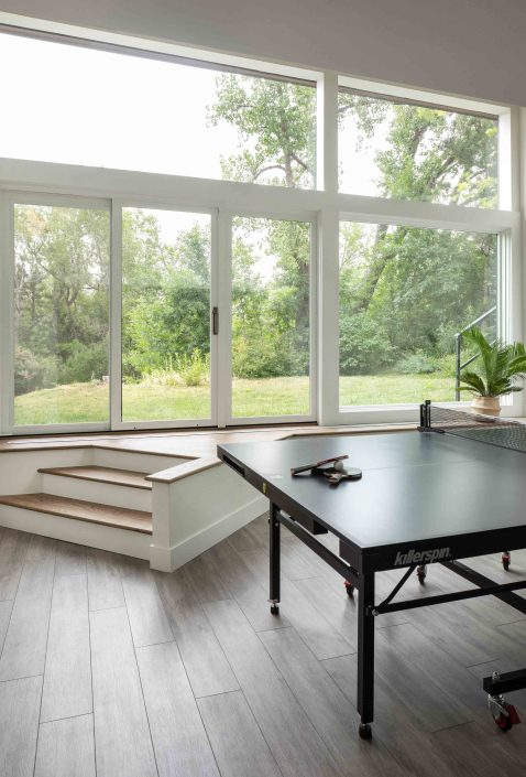 Ping pong table with view of backyard