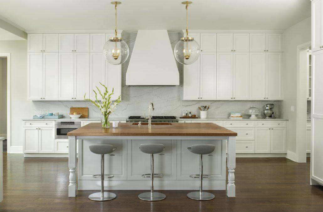 white kitchen with butcher block center island