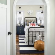 Peering into a remodeling bedroom with bed in view
