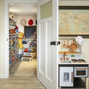 kid's playroom with cooking area and toy room