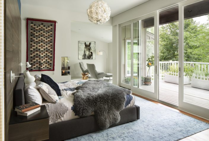 bedroom with double sliding doors to the back deck