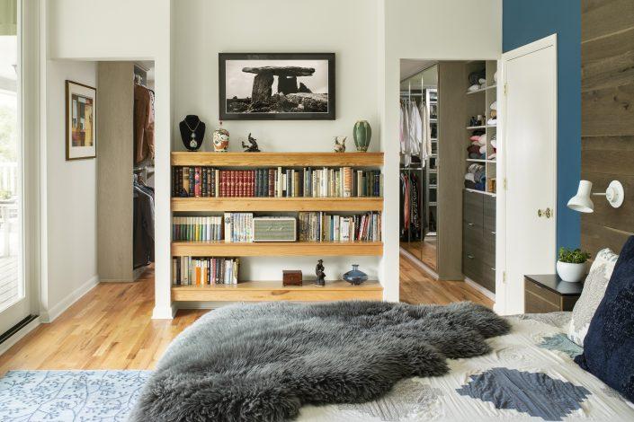 Bedroom with built-in book shelf