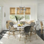 dining table with a reading nook and a lot of natural light