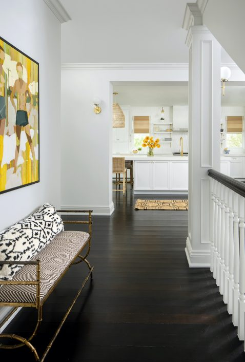 Hallway in remodeled home with panting on the wall