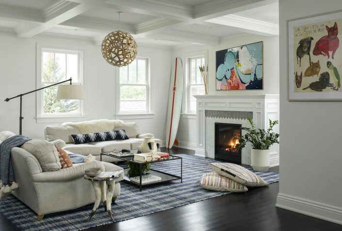 Living room with fireplace and blue rug