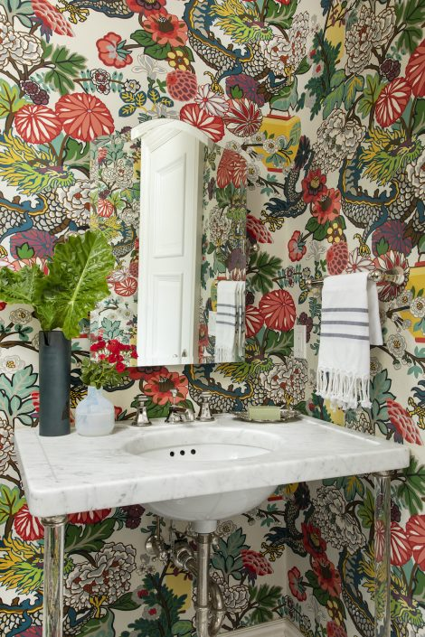 Bathroom with colorful floral wall paper