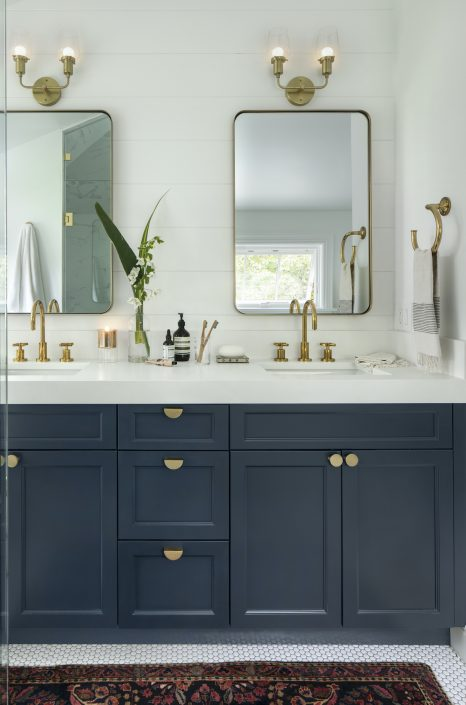 Bathroom with blue cabinets and white tile