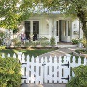 house with a white picket fence and front porch