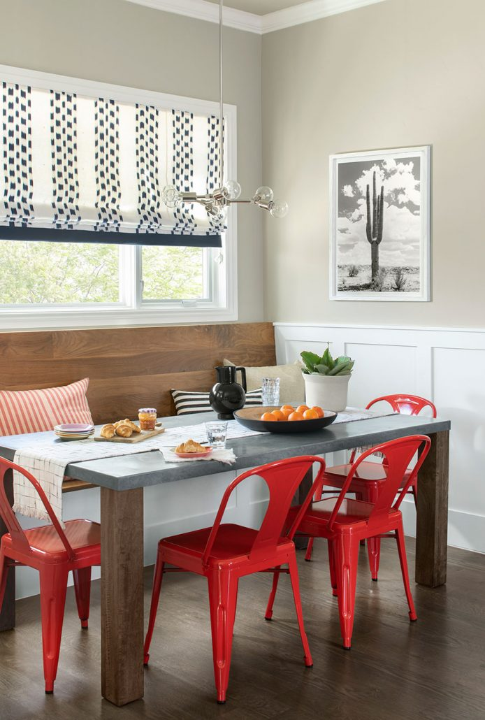 breakfast book with bench seating and red metal chairs