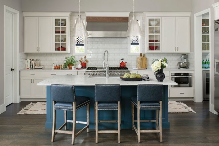 kitchen with blue cabinets and chairs contrasting with white cabinets and counters