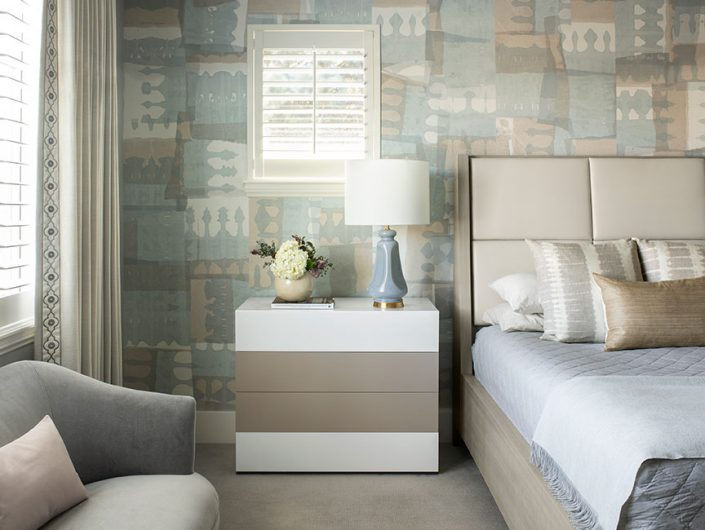 bedroom with blue and brown wallpaper