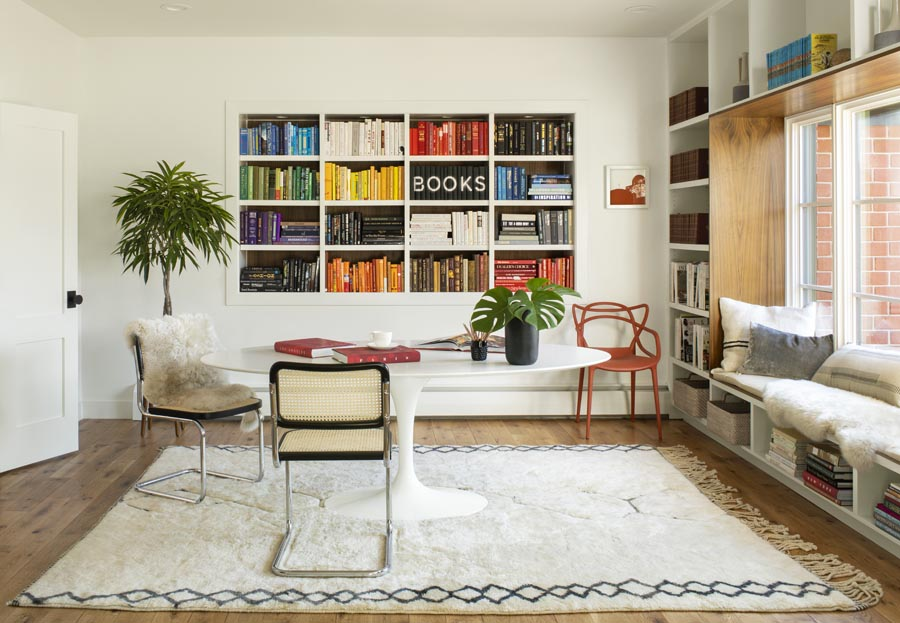 Room with built-in shelving full of books