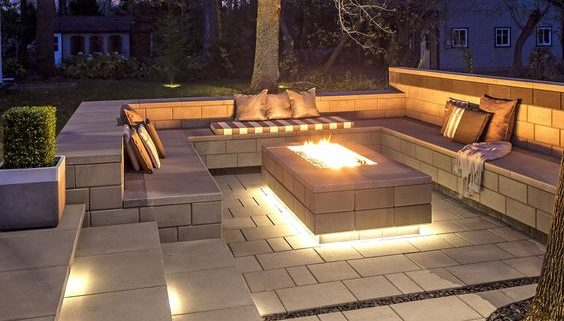 Outdoor living space with fire pit and built-in seating