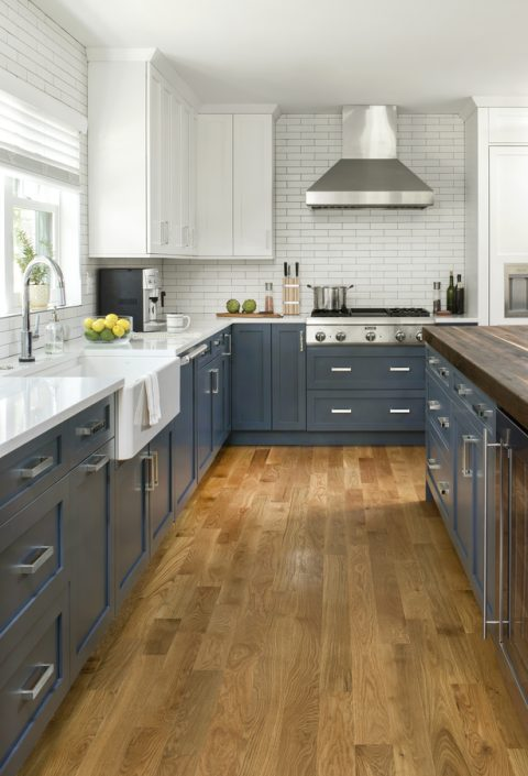 remodeled kitchen with blue cabinets and butcher block island