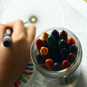 Person drawing with crayons